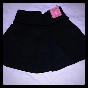 Gymboree NWT girls black skirt, size 4.